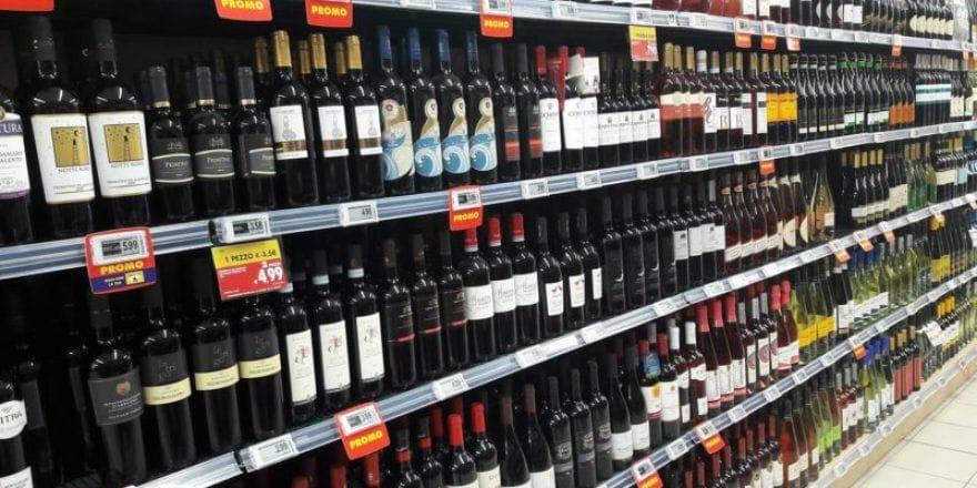 Wine bottles on the shelf in an Italian supermarket